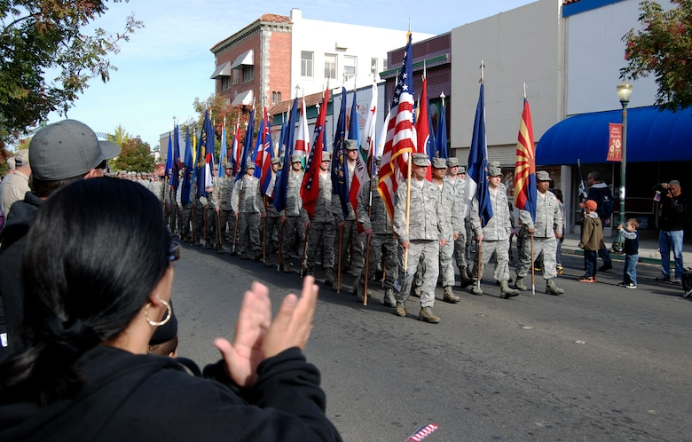 The 9th Communications Squadron marches with the state flags during the Yuba-Sutter Veterans Day Parade in Marysville, Calif., Nov. 11, 2012. More than 400 Team Beale Airmen participated in the parade. (U.S. Air Force photo by Capt. Brian Wagner/Released)