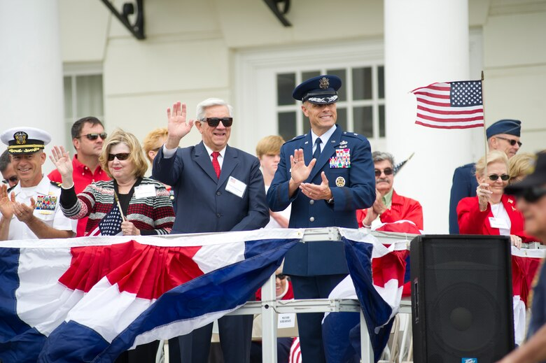 George Schloegel, Gulfport Mayor and Brig. Gen. Brad Spacy 81st Training Wing commander, Keesler Air Force Base, Miss., watch the 12th annual Gulf Coast Veteran's Parade Nov. 10, 2012, from the reviewing stands in Gulfport.   Spacy, 81st Training Wing commander, and Col. Rene Romero, 81st TRW vice commander, led participants from Keesler.  (U.S. Air Force photo by Adam Bond)