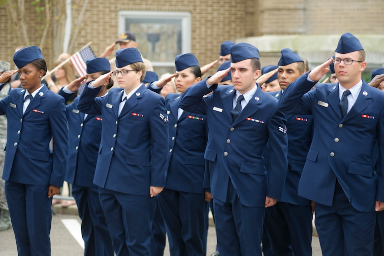 Airmen from Keesler Air Force Base, Miss., salute during the singing of the national anthem during the 12th annual Gulf Coast Veteran's Parade Nov. 10, 2012, in Gulfport.  Brig. Gen. Brad Spacy, 81st Training Wing commander, and Col. Rene Romero, 81st TRW vice commander, led participants from Keesler.  Keesler marching units included the honor guard, the 50 state flags carried by the 334th Training Squadron, student marching groups from the 335th and 336th Training Squadrons and the 81st Training Group's drum and bugle corps. (U.S. Air Force photo by Adam Bond)