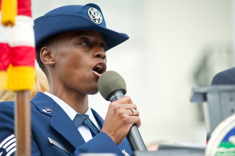 Staff Sgt. Karen Moore, 403rd Wing, Keesler Air Force Base, Miss., sings the National Anthem during the 12th annual Gulf Coast Veteran's Parade Nov. 10, 2012, in Gulfport.  Brig. Gen. Brad Spacy, 81st Training Wing commander, and Col. Rene Romero, 81st TRW vice commander, led participants from Keesler.  Keesler marching units included the honor guard, the 50 state flags carried by the 334th Training Squadron, student marching groups from the 335th and 336th Training Squadrons and the 81st Training Group's drum and bugle corps. (U.S. Air Force photo by Adam Bond)