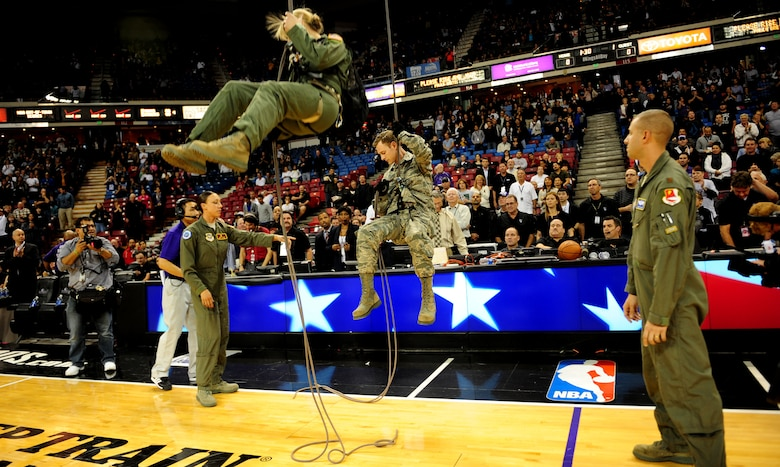 Airmen from Travis Air Force Base rappel to the floor of Sleep Train Arena during a Sacramento Kings game versus the San Antonio Spurs in Sacramento, Calif., Nov. 9, 2012. The Airmen presented the players with the game ball. (U.S. Air Force photo by Senior Airman Shawn Nickel/Released)