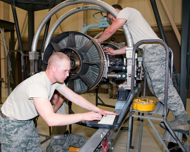 Airman Brandon Janshen, Airman Dylan Guevara and Senior Airman Wyatt Paschal, 361 Training Squadron, practice the removal of a heat shield from an engine of a F-15 aircraft Aug. 03, 2012 at Sheppard Air Force Base, Texas.  Aerospace propulsion training is broken down into four apprentice courses.  (US Air Force Photo by Frank Carter)