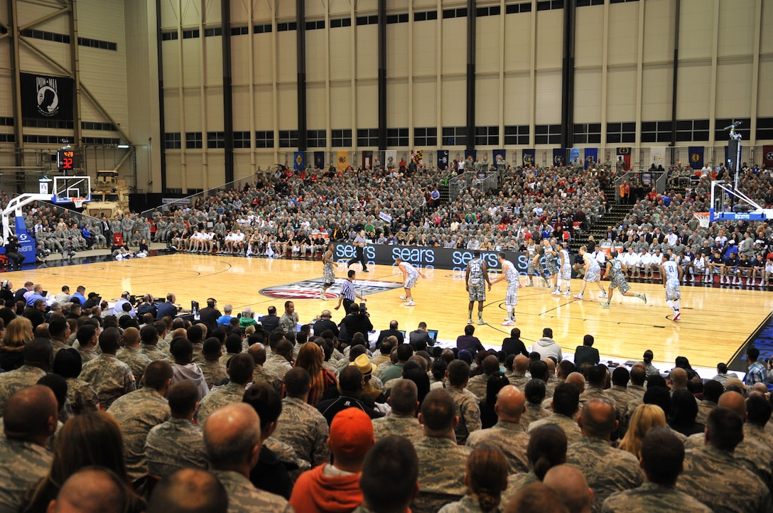 Service members watch the Armed Forces Classic basketball game between the Michigan State Spartans and University of Connecticut Huskies at Ramstein Air Base, Germany, Nov. 10, 2012.  The Huskies overcame the Spartans 66-62. (U.S. Air Force photo/Master Sgt. Wayne Clark)