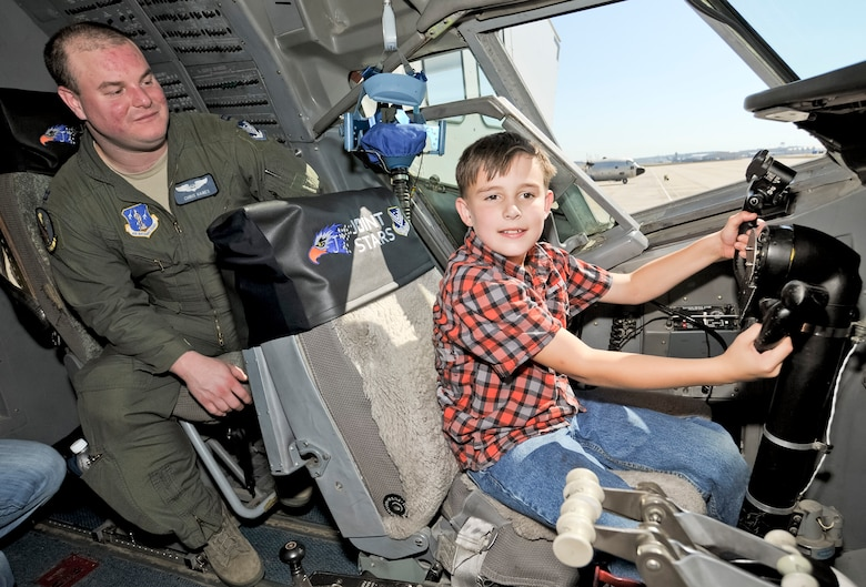 Josey Rackley learns about the E-8C Joint STARS aircraft from Capt. Christopher Hanes, 128th Airborne Command and Control Squadron, during the 116th and 461st Air Control wings annual Family Day celebration at Robins Air Force Base, Ga., Nov. 3, 2012. This marked the 10th annual Family Day for JSTARS.  The yearly event provides an opportunity to thank families for their support. (National Guard photo by Master Sgt. Roger Parsons/Released)