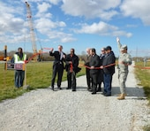 "East Chicago Mayor Anthony Copeland cuts ribbon alongside Rep. Peter Visclosky (at left) to mark completion for USACE confined disposal facility and start of Indiana Harbor dredging, East Chicago, Oct. 29, 2012. The harbor has not been dredged since 1972. ""This project will not only restore navigation but will improve water quality in southern Lake Michigan,"" said Chicago District Commander Col. Frederic A. Drummond Jr. (far right)."