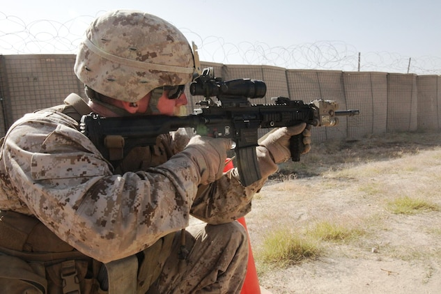 Cpl. Eric Bobst, an Infantry Automatic Rifleman with personal security detachment, 2nd Battalion, 7th Marines, Regimental Combat Team 7, fires his IAR at a close-quarters range at Forward Operating Base Sabit Qadam, Oct. 22. The IAR is replacing the M249 Light Machine Gun as the automatic weapon organic to the infantry squad.