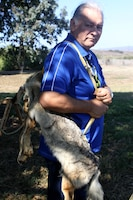 Mel Vernon, a captain of the San Luis Rey Band of Mission Indians, poses with a coyote skin bag at the Los Flores Ranch during a gathering to celebrate the historical significance of National Native American Heritage Month, Nov. 3. The bag is a replica of how members of the Luiseno and juaneno tribes would make bags from animal pelts.