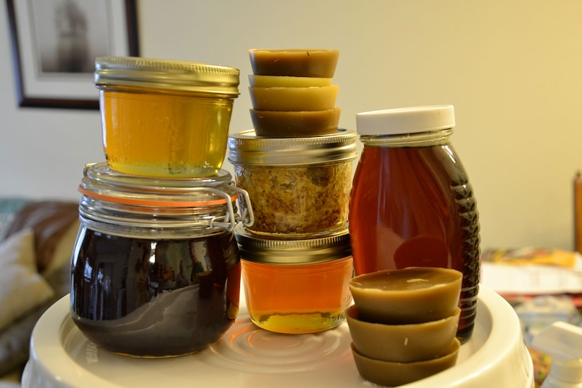 Samples of Tomlinson's and Evans' honey show different colors from different harvests throughout the year. (U.S. Air Force photo/Senior Airman Joan King)