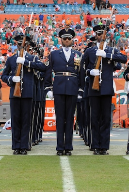 "Members of the U.S. Air Force Honor Guard Drill Team prepare to march onto the field to perfom at the Miami Dolphins ""Salute to Service"" halftime show Nov. 11, 2012, in Miami.  The Veteran's Day tribute honored veterans of military service both past and present.  (U.S. Air Force photo/Staff Sgt. Torey Griffith)"