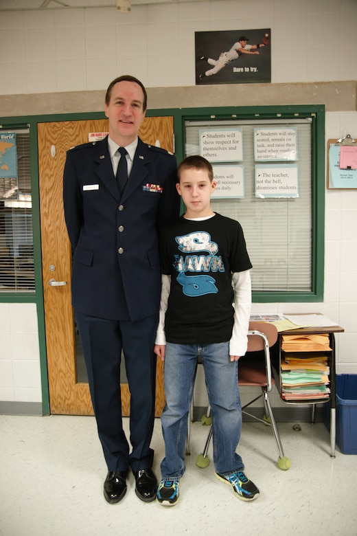 WALDORF, Md.- Retired Lt. Col. Phil Landweer stands with his grandson, sixth-grade Taylor Landweer, at  Mattawoman Middle Schools' Veterans Day program, Nov. 9, 2012.  Veterans spoke with nearly 150 students at the annual event.(U.S. Air Force photo/ Senior Airman Amber Russell)