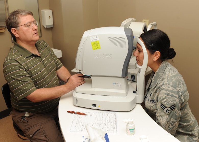 Michael Hoskins, 2nd Aerospace Medicine Squadron paraoptometric technician uses an auto-refractor on Senior Airman Karina Reyes, 2nd Contracting Squadron contracting specialist, during an eye exam on Barksdale Air Force Base, La., Nov. 14. The machine is used to obtain a baseline prescription for patients. (U.S. Air Force photo/Senior Airman Sean Martin)(RELEASED)