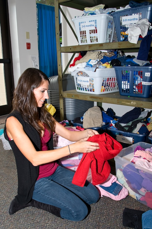 Layla Dozier, spouse of Tech. Sgt. Dayne Dozier of 373th Training Squadron and Airman's Attic volunteer, sorts clothing that was donated at the Airman's Attic on Hurlburt Field, Fla., Nov. 7, 2012. Airman's Attic is entirely run by volunteers and needs drivers to pick up donated items and make deliveries. (U.S. Air Force photo/ Airman 1st Class Michelle Vickers)