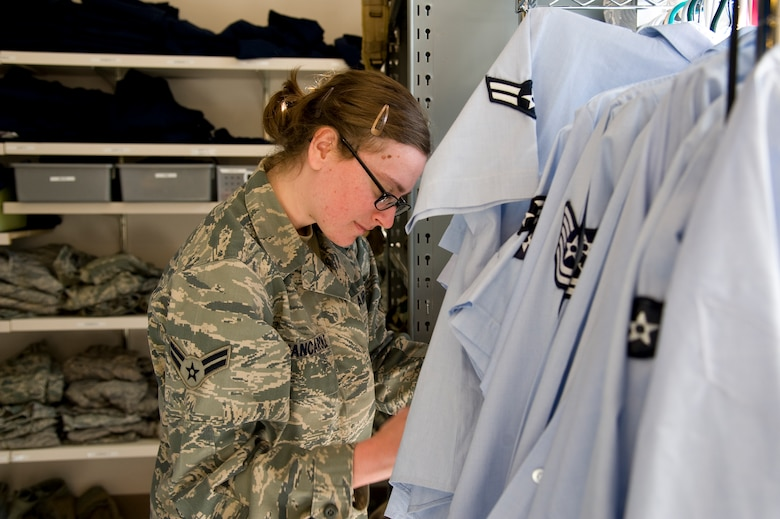 U.S. Air Force Airman 1st Class Danielle Jancarole, an intelligence analyst of 11th Intelligence Squadron, organizes blues uniform blouses at the Airman's Attic on Hurlburt Field, Fla., Nov. 7, 2012. Active-duty Airmen volunteers coordinate with their units to lend a hand at the Airman's Attic. (U.S. Air Force photo/ Airman 1st Class Michelle Vickers)