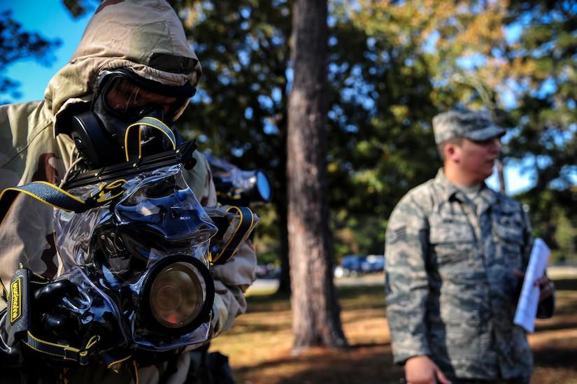 Staff Sgt. Robert Kingery, 1st Combat Camera Squadron combat videographer, simulates documenting a Chemical, Biological, Radiological, Nuclear, Explosives Defense Survival Skills training scenario Nov. 8, 2012, at Joint Base Charleston - Air Base, S.C.  1st CTCS participates in various types of training to stay mission ready as they often document first responders in humanitarian relief efforts and disasters. (U.S. Air Force photo/Staff Sgt. Rasheen Douglas)