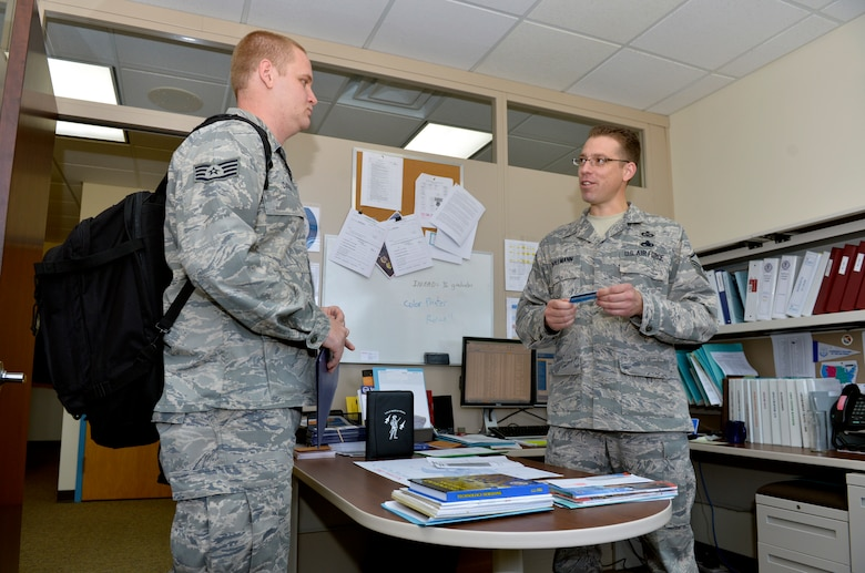 Master Sgt. Eric Bollmann, right, operations superintendent for the Paul H. Lankford Enlisted Professional Military Education Center, helps a new member of the I.G. Brown Training and Education Center process into the unit at McGhee-Tyson Air National Guard Base, Tenn., Nov. 14. Bollmann was recently recognized by the East Tennessee Military Affairs Council as an outstanding enlisted service member during the 30th Annual Veteran's Day Awards and Recognition Luncheon. (Air Force photo by Master Sgt. Kurt Skoglund)