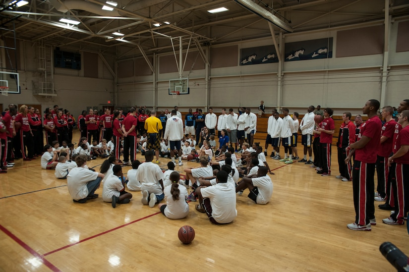 Basketball players from Ohio State, Notre Dame and Marquette University gather with military children after a Hoops from Home clinic Nov. 8, 2012, at Joint Base Charleston, S.C. Hoops from Home is a non-profit organization providing a basketball camp/clinic experience to children of military families across the world. It provides the children with an opportunity to work with players and coaches and highlight the benefits of team sports, physical activity and commitment. (U.S. Air Force photo/Airman 1st Class Ashlee Galloway)