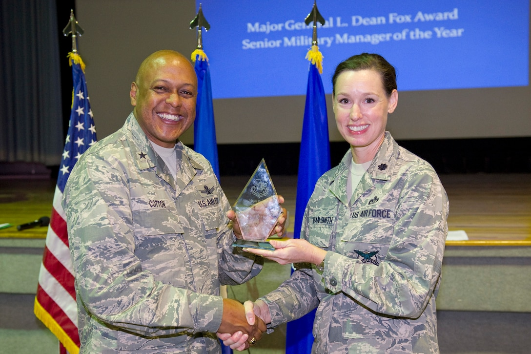 Brig. Gen. Anthony Cotton, commander, 45th Space Wing, presents the Major General L. Dean Fox Award, Senior Military Manager Category to Lt. Col. Susan Riordan-Smith, commander, 45th Civil Engineer Squadron.