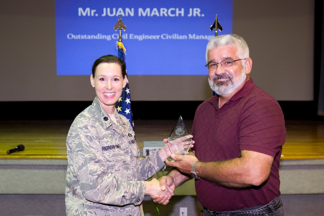 Mr. Juan March is awarded the Outstanding CE Manager of the Year, Civilian Manager Category.