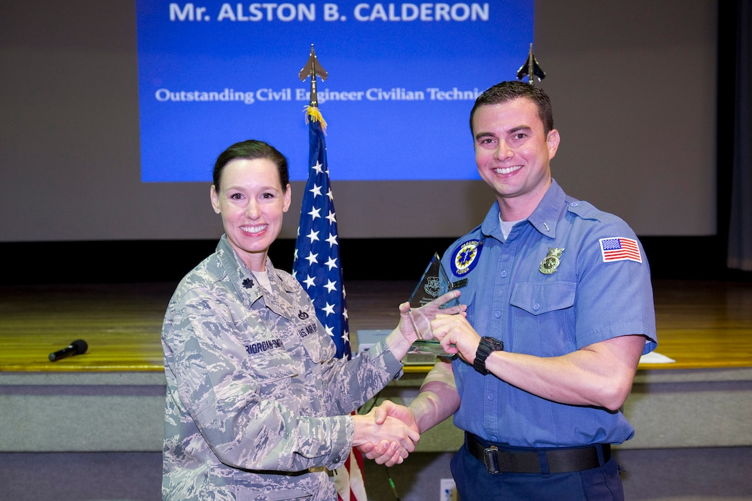 Mr. Alston Calderon is awarded the Outstanding CE Manager of the Year, Civilian Technician Category.