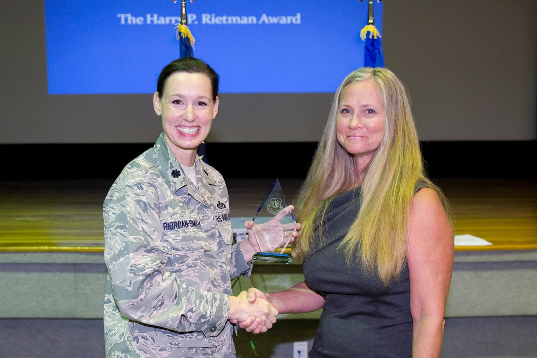 Ms. Ann Heyer is awarded the Harry P. Rietman Award, Superior Job Performance by Civilian.