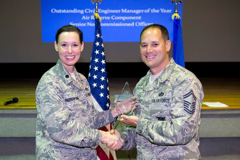 Senior Master Sgt. Terry Wooldridge is awarded the Outstanding CE Manager of the Year, ARC SNCO Category.