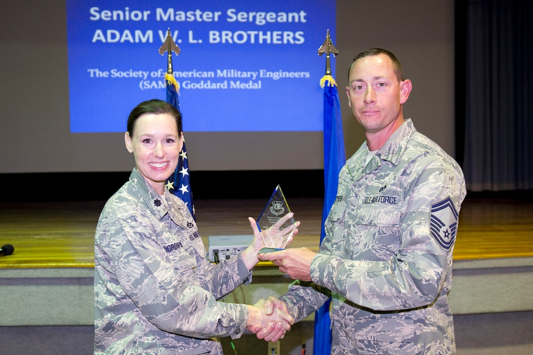 Senior Master Sgt. Adam Brothers is awarded the Goddard Medal, Enlisted Category.