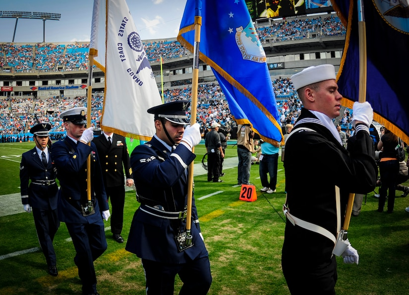 The Joint Base Charleston Honor Guard team marches off the field at the Carolina Panthers - Denver Broncos football game Nov. 11, 2012, at the Bank of America Stadium, Charlotte, N.C. The team was tasked to present the Colors during the Panthers annual Military Appreciation Day. (U.S. Air Force photo/Staff Sgt. Anthony Hyatt)