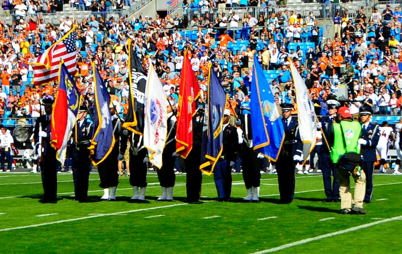 Members of Joint Base Charleston's Honor Guard present the colors during the Carolina Panthers and Denver Broncos pre-game ceremony Nov. 11, 2012, at the Bank of America Stadium in Charlotte, N.C. The Carolina Panthers hosted active duty and retired members of the military in recognition of Veterans Day. (U.S. Air Force photo/Senior Airman Ian Hoachlander)