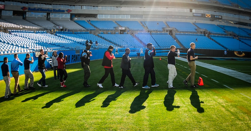 The Joint Base Charleston Honor Guard team practices presenting the Colors before the Carolina Panthers - Denver Broncos football game Nov. 11, 2012, at Bank of America Stadium,Charlotte, N.C. The Honor Guard team was invited to present the Colors for the Panther's annual Military Appreciation Day. (U.S. Air Force photo/Staff Sgt. Anthony Hyatt)
