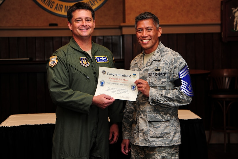 Col. Russell Fingar, 315th Airlift Wing vice commander, presents a certificate of promotion to Senior Master Sgt. Neil Mann, 315th Maintenance Squadron fabrications flight chief, at the Charleston Club Nov. 9, 2012, on Joint Base Charleston – Air Base, S.C. The Air Force has released the list of 454 senior master sergeants selected for promotion to chief master sergeant. The new E-9s were selected by an evaluation board that met in October and will join the ranks of less than one percent of the service's enlisted force. The senior noncommissioned officers who made the cut this year were selected from a pool of 1,981 eligible senior master sergeants. (U.S. Air Force photo/Staff Sgt. Rasheen Douglas)