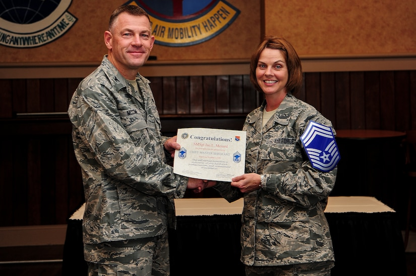 Col. Richard McComb, Joint Base Charleston commander, presents a certificate of promotion to Senior Master Sgt. Jan Menard, 628th Aerospace Medicine  Squadron bioenvironmental engineering flight chief, at the Charleston Club Nov. 9, 2012, on Joint Base Charleston – Air Base, S.C. The Air Force released the list of 454 senior master sergeants selected for promotion to chief master sergeant. The new E-9s were selected by an evaluation board that met in October and will join the ranks of less than one percent of the service's enlisted force. The senior noncommissioned officers who made the cut this year were selected from a pool of 1,981 eligible senior master sergeants. (U.S. Air Force photo/Staff Sgt. Rasheen Douglas)