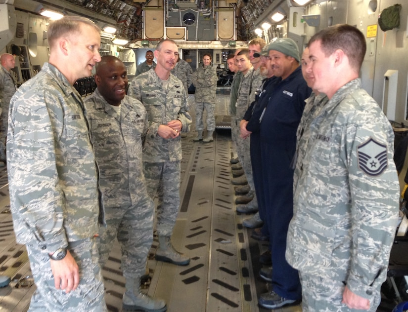 Col. Darren Hartford, 437th Airlift Wing commander, and Chief Master Sgt. Larry Williams (third from left) recognize a group of 20 maintainers from the 437th Aircraft Maintenance Squadron, 437th Maintenance Squadron and Boeing engineers inside a C-17 Nov. 7, 2012, at Joint Base Charleston – Air Base, S.C. Hartford congratulated several members of the group with command coins. The maintenance team, led by Master Sgt. Charles Johnson of the 437th AMXS (second from left), showed outstanding dedication and perseverance and spent more than 600 man hours repairing a C-17 with an extensive history of cargo door pressurization problems. Hartford specifically addressed the group's excellent work ethic, immaculate attention to detail and exceptional team work with the Boeing Company since the arrival of the first C-17.  (U.S. Air Force photo/Lt. Col. Ryan White)