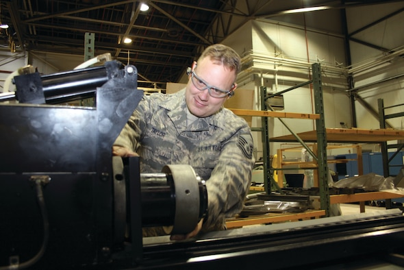 WRIGHT-PATTERSON AIR FORCE BASE, Ohio - Master Sgt. Josef Taylor, 445th Maintenance Group aircraft quality assurance instructor, uses a hydraulic aircraft tubing repair machine. The machine bends tubing in many different ways. (U.S. Air Force photo/Ken LaRock)