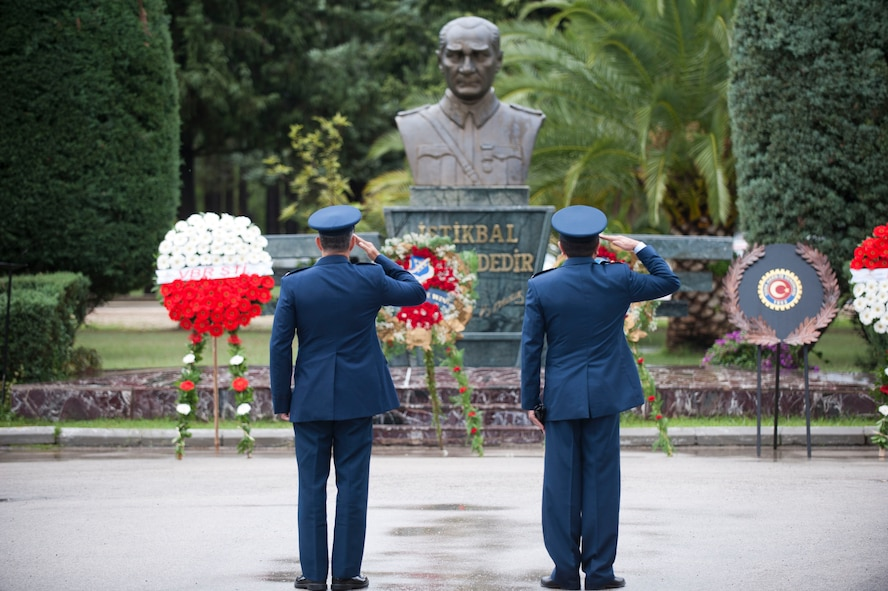 Col. Sean Gallagher, left, 39th Mission Support Group commander, and Turkish air force Lt. Col. Abdullah Demirel, 101st Air Refueling Squadron commander, salute a monument of Mustafa Kemal Ataturk during the Ataturk Memorial Day Ceremony Nov. 10, 2012, at Incirlik Air Base, Turkey. The ceremony brought members from across the base together to honor Ataturk, the founder and first president of modern Turkey. (U.S. Air Force photo by Senior Airman Clayton Lenhardt/Released)