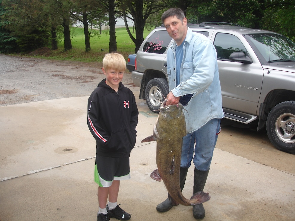Father and Son with catfish