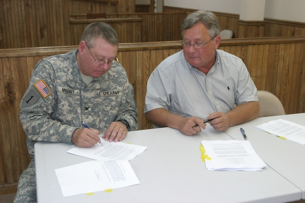 Little Rock District Commander Col. Glen Masset and Augusta Mayor Rocky Tidwell sign a Project Partnership Agreement to proceed with a streambank protection project. Heavy rains in the spring of 2008 and 2009 caused serious bank erosion along the White River near Augusta's downtown area.