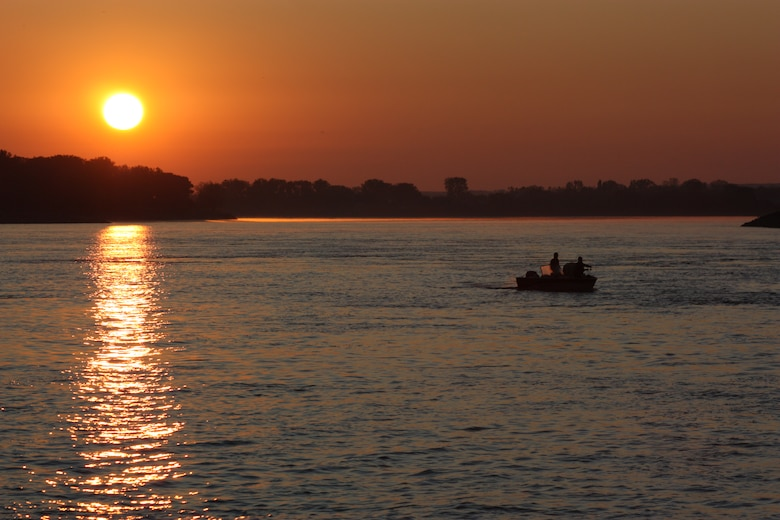 Boater fishing in Missouri River early one morning.