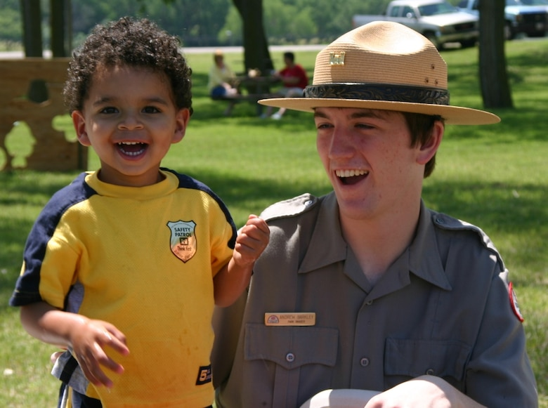 Park Ranger Andy Barkley with a young visitor at a water safety program.