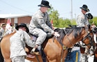 Capt. John Furr, fire support officer, 5th Sqdn., 4th Cav. Regt., receives his spurs atop a horse from the CGMCG during the squadron's Spur Ride ceremony.  Photo by: Sgt. Daniel Stoutamire, 2ND ABCT.