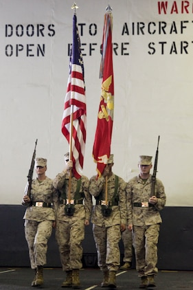 The color guard from Marine Medium Helicopter Squadron 364 (Rein.), 15th Marine Expeditionary Unit, march out before the national anthem was played during the 237th Marine Corps Cake Cutting Ceremony held in the hangar bay of the USS Peleliu, Nov. 10. The 15th MEU is deployed as part of the Peleliu Amphibious Ready Group as a theater reserve and crisis response force throughout U.S. Central Command and the U.S. 5th Fleet area of responsibility.