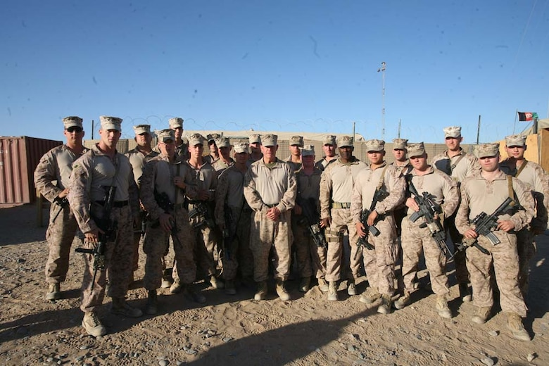 Major Gen. Charles M. Gurganus, Regional Command (Southwest) commanding general, poses for a photograph with Marines at Combat Outpost Rankel, Afghanistan, Nov.10, 2012. Maj. Gen. Gurganus and RC(SW) Sgt. Maj. Harrison Tanksley spent the 237th Marine Corps birthday traveling to  every position in southern Helmand province that had Marines to wish them a happy birthday.