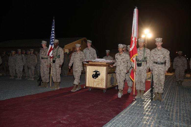 Marines wheel out a cake during Regional Command (Southwest)'s cake cutting ceremony in honor of the 237th Marine Corps Birthday, Nov. 10, 2012, aboard Camp Leatherneck, Afghanistan.
