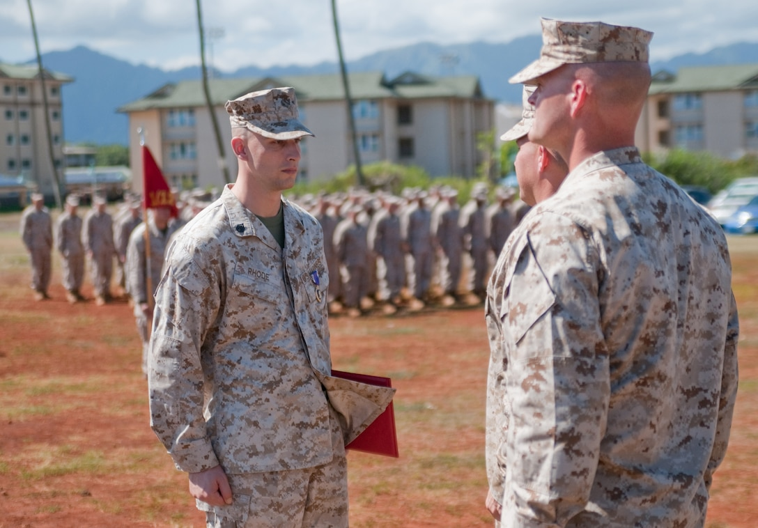 Staff Sgt. Cody Rhode stands at attention after receiving a Purple Heart Medal during a formation near the battalion offices, Nov. 2. Rhode, a native of Rogers City, Mich., was shot five times during an attack in Garmsir District, Afghanistan Aug. 10. During this same attack, three Hawaii-based Marines were killed — Staff Sgt. Scott E. Dickinson, Cpl. Richard A. Rivera Jr. and Lance Cpl. Gregory T. Buckley.