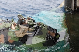 Marines drive an assault amphibious vehicle aboard the USS Denver during Exercise Keen Sword 2013 Nov. 9. U.S. military and Japan Ground Self-Defense Force personnel are training alongside each other at locations throughout Japan during Keep Sword, a regularly-scheduled, joint, bilateral exercise. The Marines are with Combat Assault Battalion, 3rd Marine Division, III Marine Expeditionary Force.