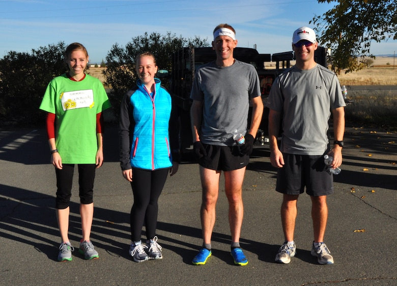 The top two male and female runners from the Turkey Trot 5K pose for picture at Beale Air Force Base, Calif., Nov. 14, 2102. Jessica Clayton(Far left) finished first overall with a time of 18:37. (U.S. Air Force photo by Staff Sgt. Robert M. Trujillo/Released)