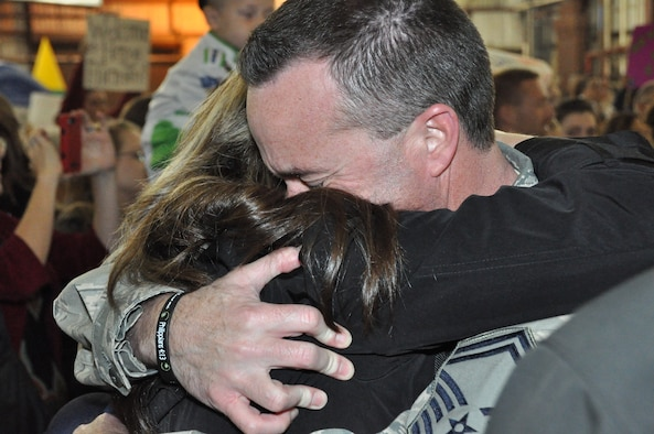 Senior Master Sgt. Mike Gibson, an Air Surveillance Technician assigned to the 970th Airborne Air Control Squadron, hugs his wife, Shawna. Eighty nine reservists returned Sunday night from a 6-month activation supporting Operation Enduring Freedom in Southwest Asia. (U.S. Air Force Photo by Tech. Sgt. Sandra Hatton)