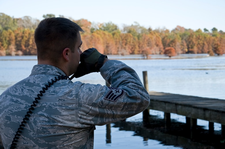 Staff Sgt. David Wales, 2nd Security Forces Squadron game warden NCO in charge, answers a call on his radio while on patrol on Barksdale Air Force Base, La., Nov. 14. The game wardens are responsible for 18,000 acres of forest and wetland that make up the East Reservation. (U.S. Air Force photo/Staff Sgt. Chad Warren)(RELEASED)