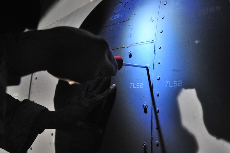 U.S. Air Force Staff Sgt. Charles Phillips, 727th Special Operations Aircraft Maintenance Squadron, removes screws from an air filter housing compartment on a CV-22 Osprey on the flightline at Cannon Air Force Base, N.M., Nov. 2, 2012. The $80 million aircraft relies on routine austere inspections and preventative maintenance for proper functionality as well as Air Force Special Operations Command compliance. (U.S. Air Force photo/Airman 1st Class Alexxis Pons Abascal)