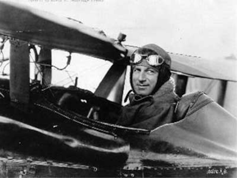 """Then-Brig. Gen. William Mitchell sits in a Curtiss R-6 biplane at Selfridge Field on or about Oct. 18, 1922, while participating in the National Airplane Races at Selfridge. During the event, Mitchell set an """"official"""" air speed record of 224.05 miles per hour, while flying a course over Lake St. Clair. Several days earlier, Lt. Russell L. Maughan had flown at 248.5 miles per hour, but the official observers had not yet arrived at Selfridge to verify that feat."""