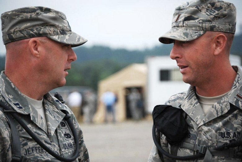 2nd Lt. Jonathan Fairbanks (right), 123rd Force Support Squadron Fatality Search and Recovery Team officer in charge, talks with Airzona FSRT officer in charge Capt. Paul W. Jefferson during Patriot 12 at Volk Field, Wis. July 15, 2012. (Courtesy photo)